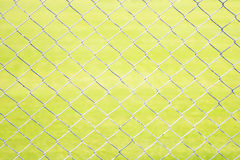 Wire Mesh Fence Close-Up on Green Background Royalty Free Stock Images