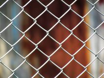 Wire Mesh fence with old zinc background royalty free stock images