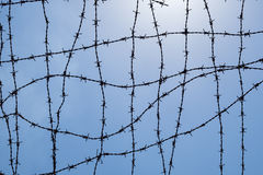 Wire mesh fence with sky Royalty Free Stock Image