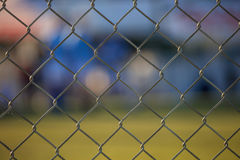 Wire mesh fence - Soccer field abstract Royalty Free Stock Image