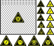 Wire mesh fence and warning signs Royalty Free Stock Photos