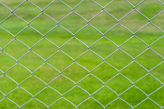 Wire mesh with green background Royalty Free Stock Image