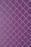 Wire Mesh, iron wire fence on the wall purple Stock Photography