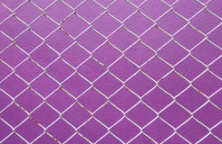 Wire Mesh, iron wire fence on the wall purple Stock Images