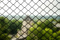Imperfect wire mesh pattern. With a blurred background stock photos