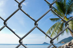 Wire mesh on sea view background Royalty Free Stock Images