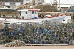 Wire mesh shellfish traps piled in marina stock photography