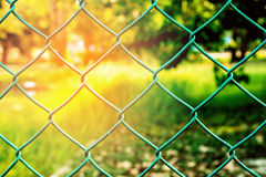 Wire mesh of the stadium stock image