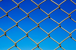 Wire mesh steel on blue sky background Royalty Free Stock Images