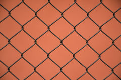 Wire mesh steel , fence with orange background. Wire mesh , fence with orange background Stock Photo
