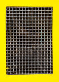 Wire metal net border yellow background Royalty Free Stock Photo