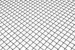 Wire netting. The fence of wire netting on the background of blue sky Royalty Free Stock Photo