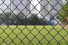 Wire netting. With football field as background Stock Photos