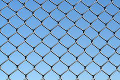 Wire netting. And blue sky royalty free stock photos
