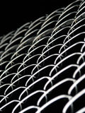 Wire netting. On a black background Royalty Free Stock Images