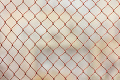 Wire netting as background. Over earth Royalty Free Stock Images