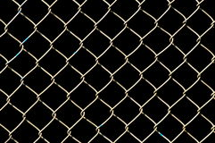 Wire netting. On black background Royalty Free Stock Photos