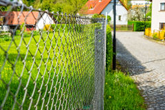 Wire netting fence as a delimitation of the property Royalty Free Stock Images