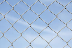 Wire netting fence. With blue sky Stock Images
