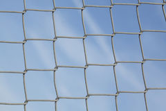 Wire netting fence. With blue sky Royalty Free Stock Image