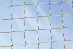 Wire netting fence. With blue sky Royalty Free Stock Photos