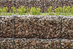 Wire netting gabion box wall Stock Images