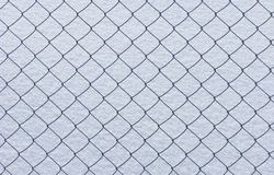 Wire netting on snow background Stock Photos