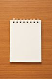 Wire-o notepad. On wooden desk background Stock Photo