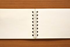 Wire-o notepad. On wooden desk background Stock Images