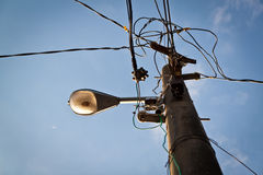 Wire pole with street lamp Stock Photography