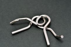 Wire puzzle (Puzzle ring) Stock Photos