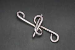 Wire puzzle (Puzzle ring) Stock Photography