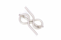 Wire puzzle (Puzzle ring). The Wire puzzle (Puzzle ring) on a white background Royalty Free Stock Image