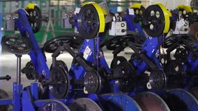 Wire reinforcement of modern tires in a factory. Tires production. Wire reinforcement of modern tires in a factory. Rotating and reeling metal threads bobbins stock footage