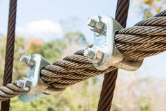 Cable linked. Wire rope binding. Cable linked together by steel clamp royalty free stock image