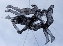 Wire sculptures. Hanging above the street Stock Photo
