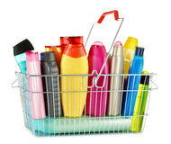 Wire shopping basket with body care and beauty products. Wire shopping basket with plastic bottles of body care and beauty products Royalty Free Stock Photo