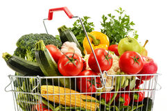 Wire shopping basket with groceries isolated on white Stock Photo