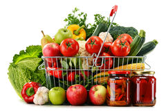 Wire shopping basket with groceries isolated on white Stock Photography