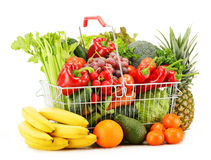 Wire shopping basket with groceries on white Stock Photos