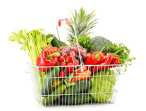 Wire shopping basket with groceries on white Stock Photography