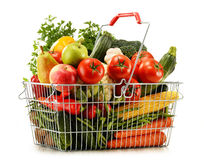 Wire shopping basket with groceries on white Royalty Free Stock Photo