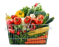 Wire shopping basket with groceries on white Stock Image