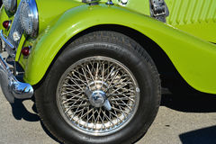 Wire-spoked wheel of a vintage Morgan Plus 4 roadster classic Royalty Free Stock Photo