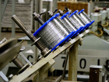 Wire spools. Spools of wire on stitching machine in publishing plant royalty free stock photos