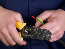 Wire stripper in the hands