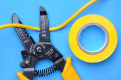 Wire stripper, insulation tape and cable Royalty Free Stock Photos