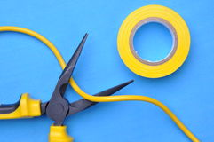 Wire stripper, insulation tape and cable Royalty Free Stock Photography