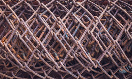 Wire texture. A coil of mesh netting. Old rusty roll of wire mesh. Building material and metal texture. The pattern of metal threads Stock Photos