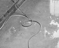 WIRE ON WET CONCRETE GROUND Royalty Free Stock Photos